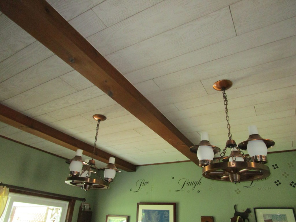 View of beamed box ceiling main house